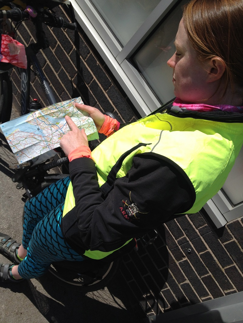 Sarah navigating with a road map for cycling